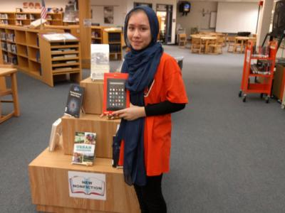 student poses with her new Kindle
